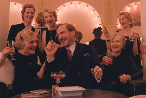 Gustave having a laugh with his women