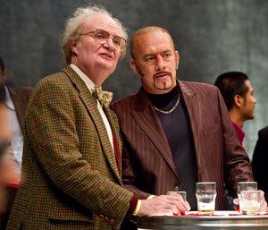 Jim Broadbent and Tom Hanks as Dermot Hoggins having a drink