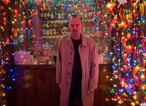 Michael Keaton surrounded by Christmas lights - Birdman