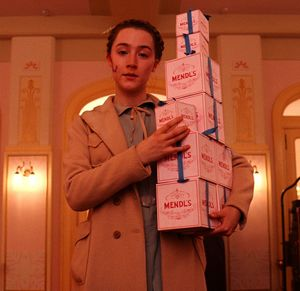 Saoirse Ronan as Agatha with a bunch of Mendl's boxes - The