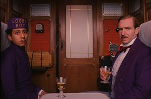 Lobby Boy and Gustave on train in Wes Anderson's The Grand B