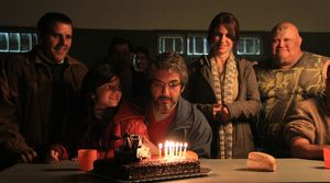 Ricardo Darín blows out the candles as Simón Fisher in Wil