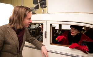 Wes Anderson with Tilda Swinton behind the scenes of The Gra