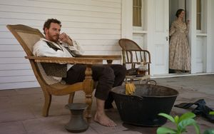 Michael Fassbender as Edwin Epps looking over his slaves fro