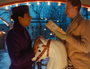 Tony Revolori and Saoirse Ronan having a moment on a horse