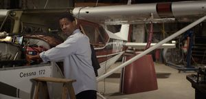 Denzel working on a plane