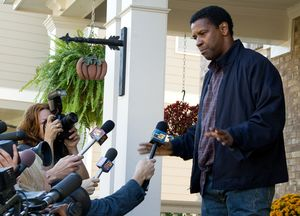 Denzel Washington holds off the press at his home - Flight
