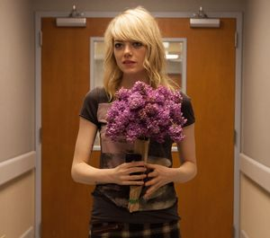 Emma Stone as Sam with flowers smirking - Birdman