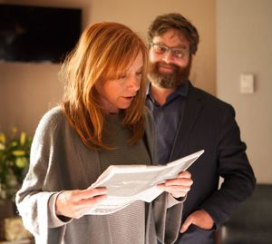 Zach Galifianakis proud as Amy Ryan reads the paper in Birdm