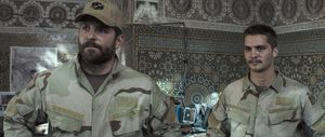 Brian Hallisay and Bradley Cooper in American Sniper