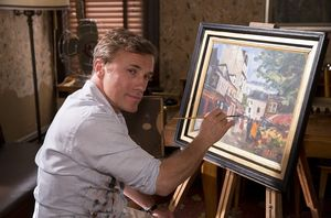 Keane (Christoph Waltz) paints a landscape.