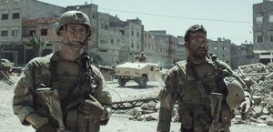 Jake McDorman and Bradley Cooper on the street in American S