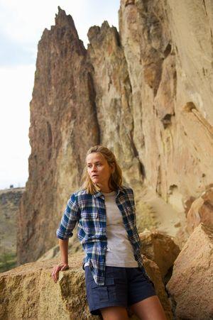 Reese Witherspoon between rocks