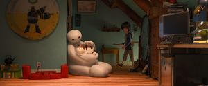 The lovable Baymax stroking a cat