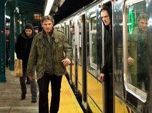 Liam Neeson paces the platform
