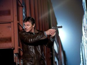Liam Neeson armed