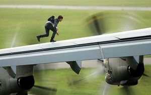Tom Cruise on airplane wing