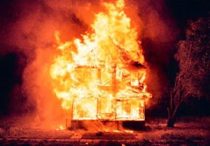 the symbol of lost hope, a house on fire