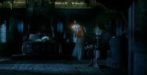 Mia Wasikowska with candles in a dark room, Crimson Peak