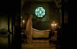 Mia Wasikowska and old bathtub in Crimson Peak