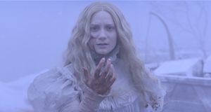 Mia Wasikowska with bloody hand in Del Toro's Crimson Peak