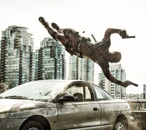 Ryan Reynolds flies around some bullets as Deadpool