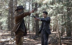 Michael Fassbender, Kodi Smit-McPhee and two guns in Slow We