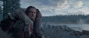 Leonardo DiCaprio carries a man on his back in 'The Revenant