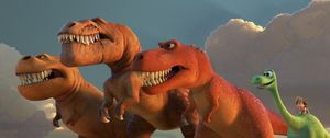 Arlo and some T-Rexes in The Good Dinosaur