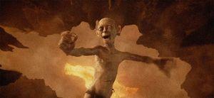 Gollum falls into mount doom with ring, happy