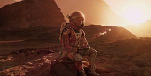 Matt Damon sits in the Mars Sun