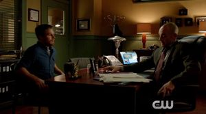 Oliver Queen confronts Captain Lance about alliance with Dam