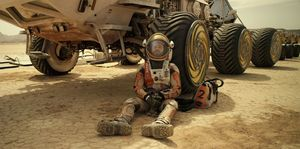 Matt Damon sits around near his space vehicle