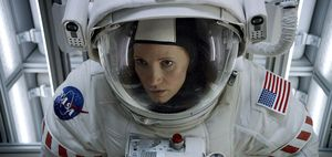 Chastain in huge space suit