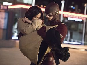 The Flash rescuing Earth-1 Linda Park from Earth-2 Dr. Light