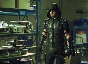 Oliver Queen/Green Arrow on mission to rescue Ray Palmer/ATO