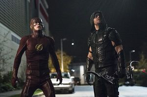 The Flash, Green Arrow looking up at threat