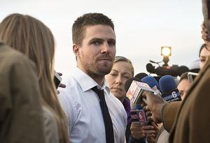 Mayoral candidate Oliver Queen gives press interviews after