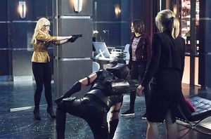 Brie Larvin holding Team Arrow at gunpoint