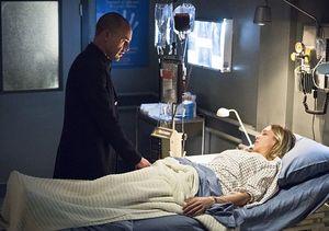 Quentin Lance at daughter Laurel's bedside