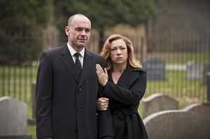 Quentin and Dinah Lance at daughter Laurel's funeral