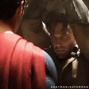 Bruce Wayne stares down Superman