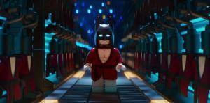 Batman, half in costume