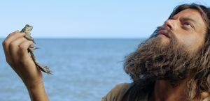 Rami Malek as Buster