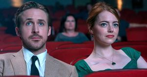 Ryan Gosling and Emma Stone watch a movie in 'La La Land'