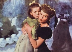 Judy Garland comforts a young Margaret O'Brien