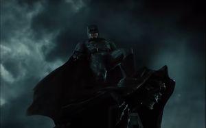 Batman atop a gargoyle