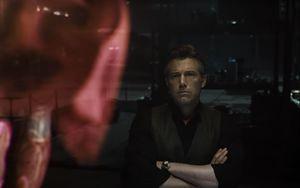 Bruce Wayne looking at the hologram of Superman