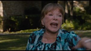 Jack Black tries to drive away, but Shirley MacLaine closes the gate in Bernie