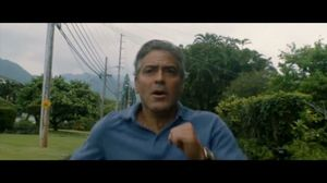 George Clooney runs in The Descendants